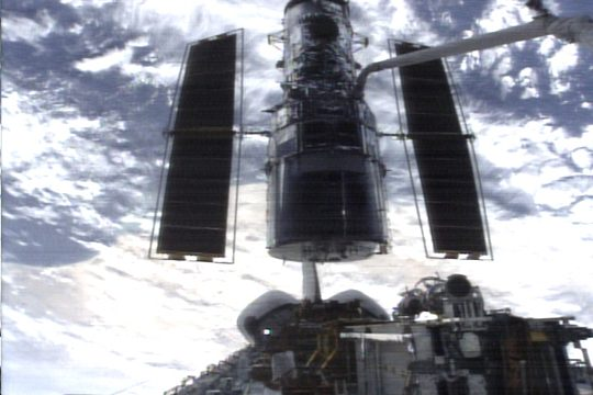 Hubble space telescope being grappled by shuttle Columbia (3 March 2002) Source: NASA Servicing Mission 3B Multi-Media Gallery 3_grapple_01.jpg