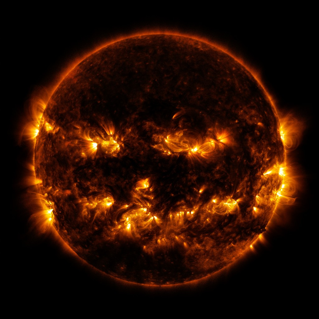 On October 8, 2014, active regions on the sun gave it the appearance of a jack-o'-lantern. This image is a blend of 171 and 193 ångström light as captured by the Solar Dynamics Observatory.